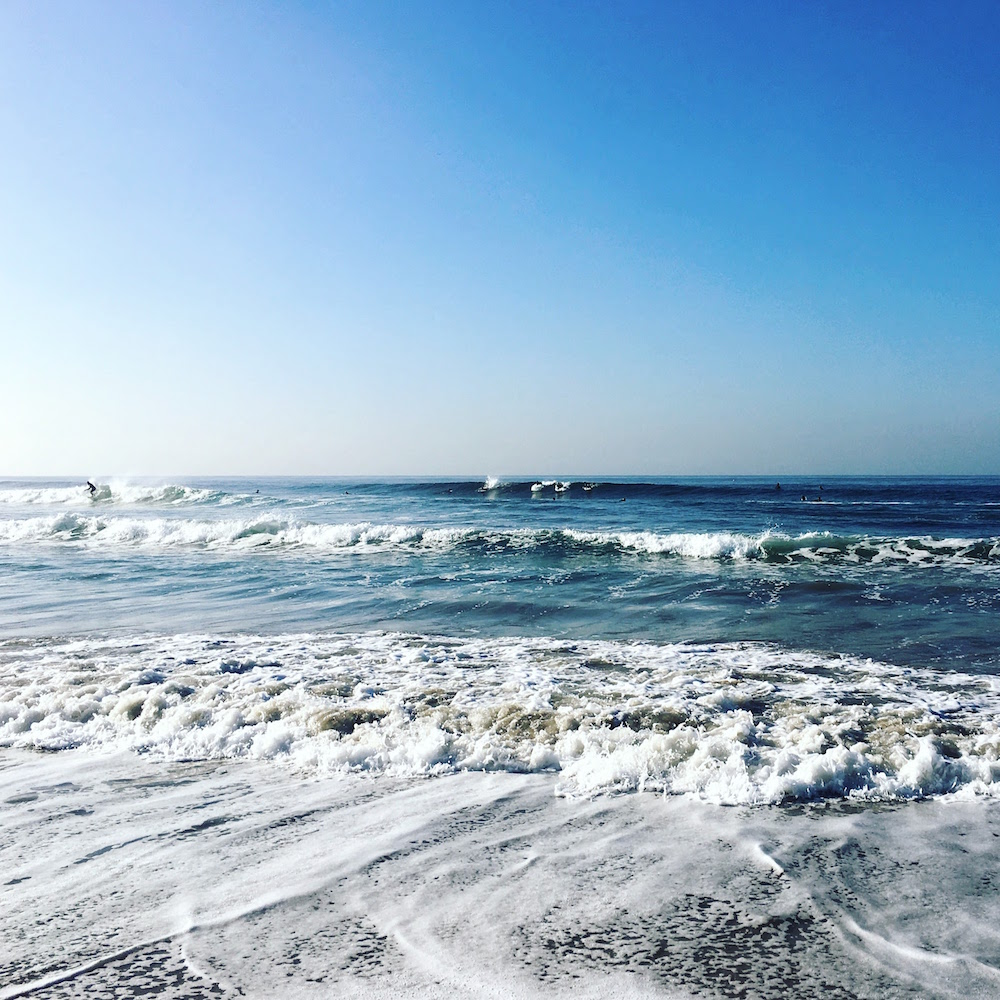 Watching the morning surfers on Venice Beach. Photo by Melanie Biehle.